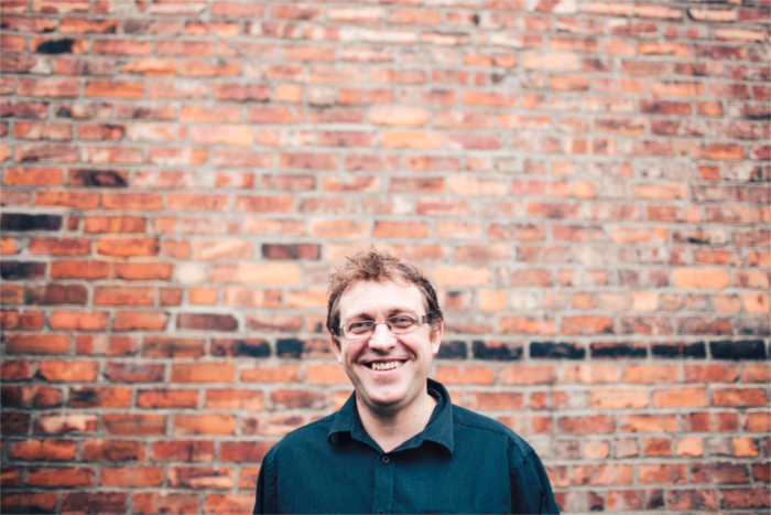 Picture of Paul smiling - Contact details for Paul at his offices, office address for visitros and contact form - Paul Cowham Accountancy - Manchester based accountant specialising in the charity and social enterprise sectors