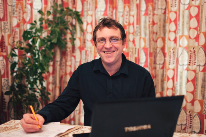 Picture of Paul Cowham sitting at his desk - Information about Paul Cowham - Paul Cowham Accountancy - Manchester based accountant specialising in the charity and social enterprise sectors